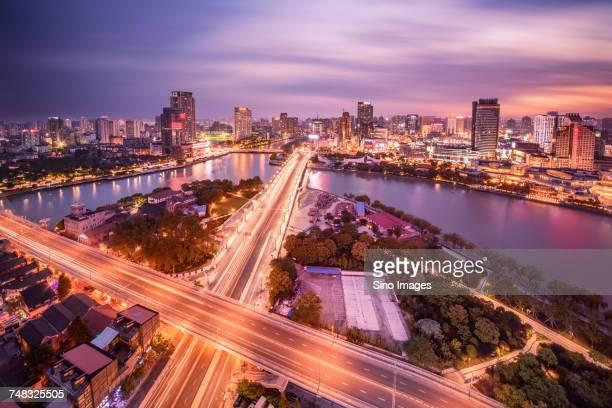 illuminated overpass and city at sunset, ningbo, zhejiang, china - ningbo stock pictures, royalty-free photos & images