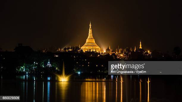 Illuminated Pagoda Against Clear Sky With Waterfront