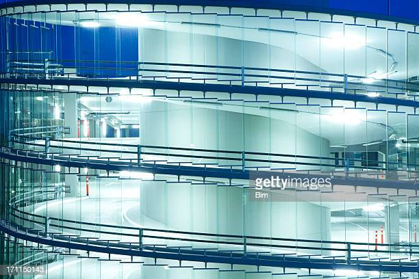 illuminated parking garage at night - parking garage stock pictures, royalty-free photos & images