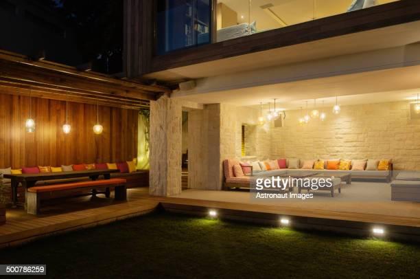 Illuminated patios with benches at night