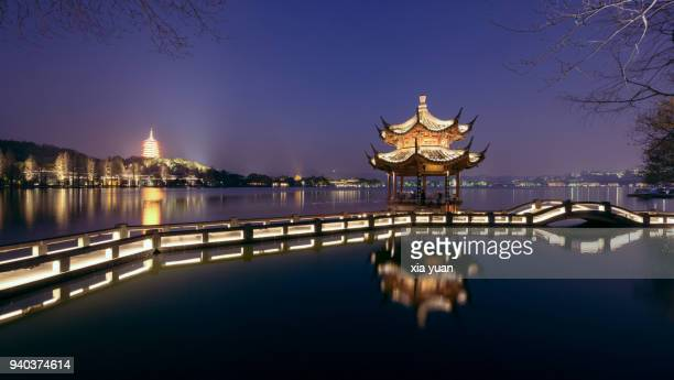 illuminated pavilion against the leifeng pagoda by the west lake,hangzhou,china - pavilion stock pictures, royalty-free photos & images