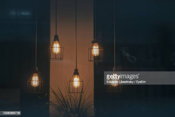 Illuminated Pendant Lights Hanging At Home