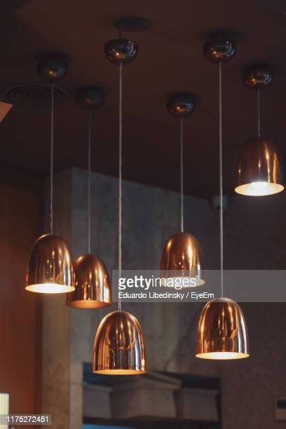 illuminated pendant lights hanging from ceiling - pendant light stock pictures, royalty-free photos & images