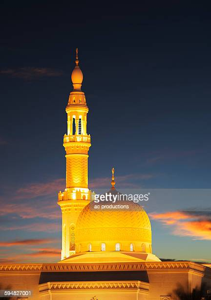 illuminated pillar and dome under sunset sky - minaret stock pictures, royalty-free photos & images
