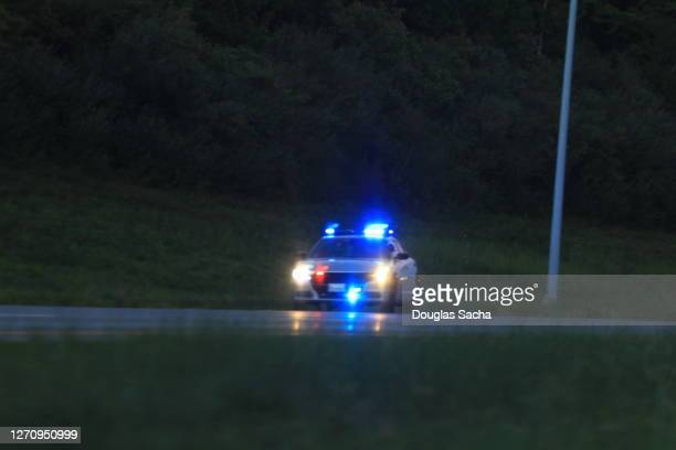 illuminated police car lights and sirens - police vehicle lighting stock pictures, royalty-free photos & images