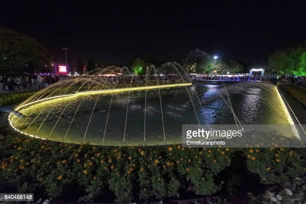 illuminated pond at international fair,izmir. - emreturanphoto stock pictures, royalty-free photos & images