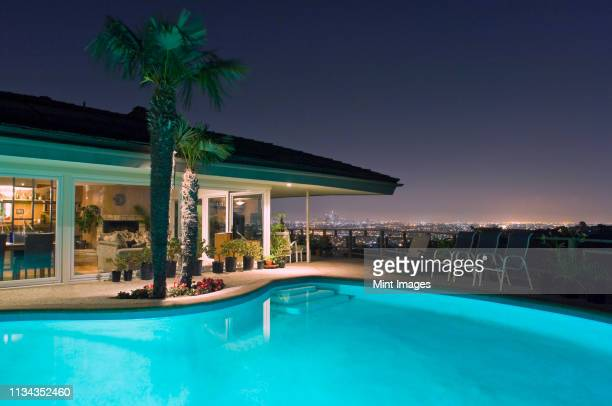 illuminated pool at night with city in background, los angeles, california, united states - standing water stock pictures, royalty-free photos & images