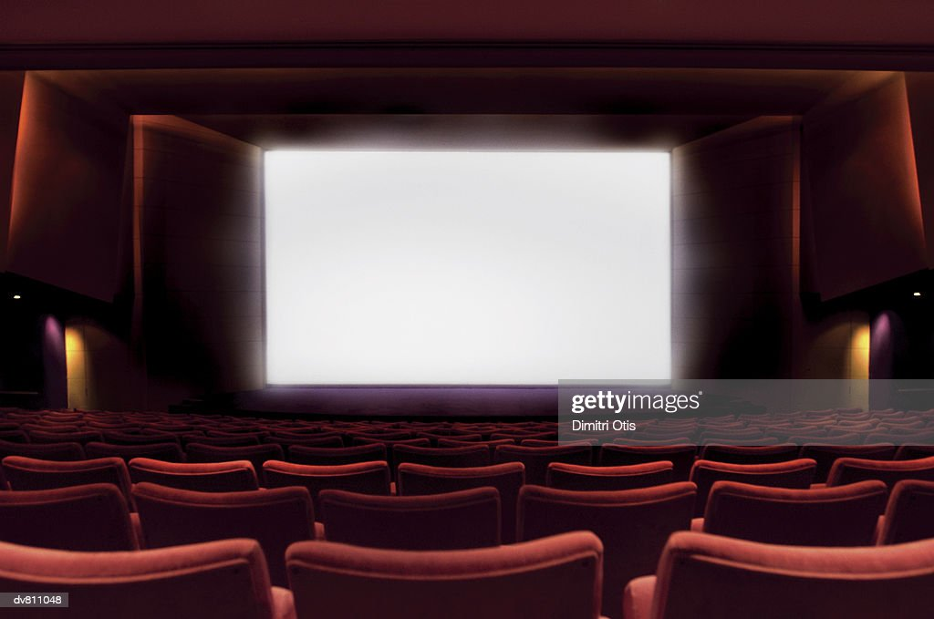 Illuminated Projection Screen in An Empty Cinema : Stock Photo