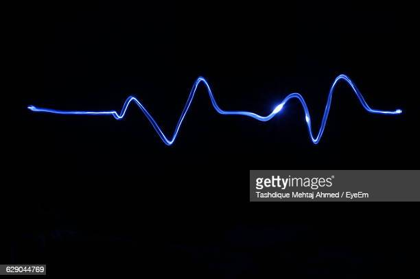 Illuminated Pulse Trace Against Black Background