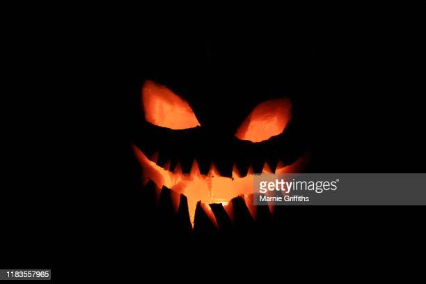 illuminated pumpkin - halloween wallpaper stock pictures, royalty-free photos & images