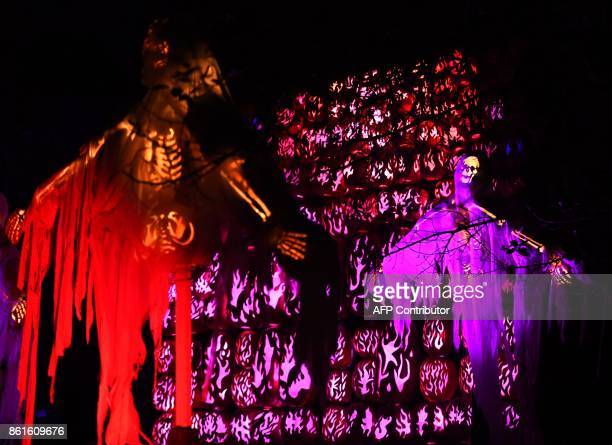 Illuminated pumpkins are on display during the Great Jack O'Lantern Blaze at Van Cortlandt Manor in CrotononHudson New York on October 14 2017 The...