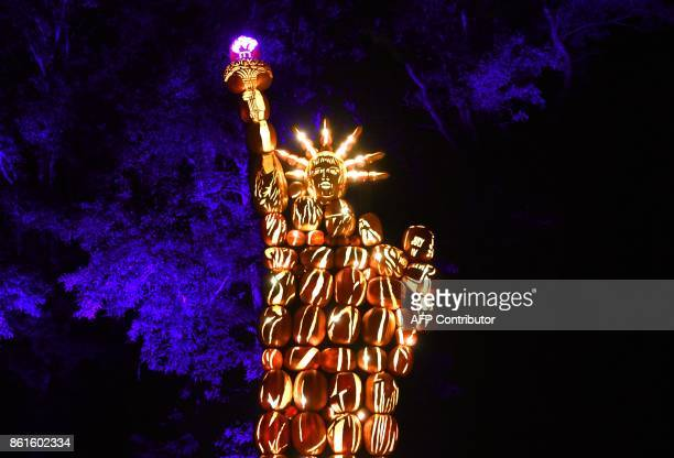 Illuminated pumpkins in the shape of the Statue of Liberty are on display during the Great Jack O'Lantern Blaze at Van Cortlandt Manor in...