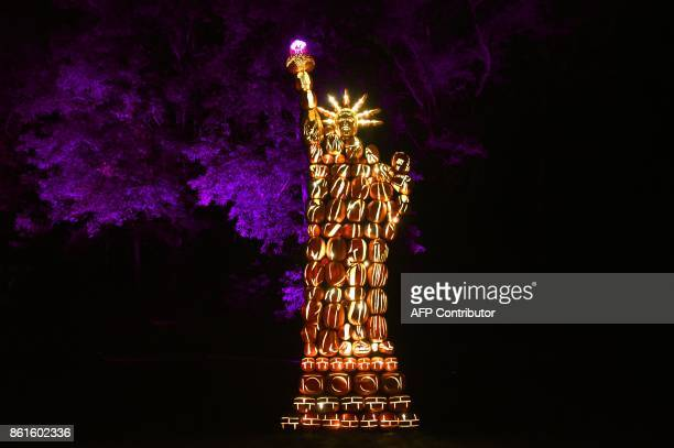 TOPSHOT Illuminated pumpkins in the shape of the Statue of Liberty are on display during the Great Jack O'Lantern Blaze at Van Cortlandt Manor in...