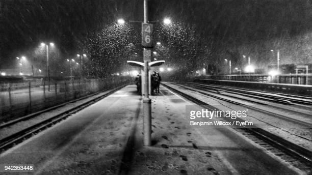 illuminated railroad station at night during winter - gillingham stock pictures, royalty-free photos & images