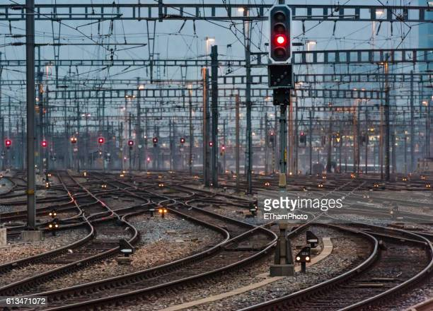 illuminated railway track field and switches at twilight - shunting yard stock photos and pictures