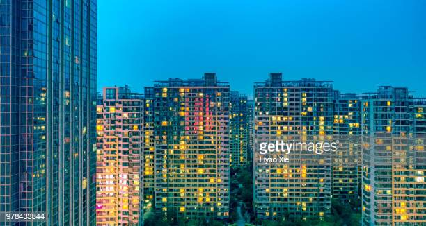 illuminated residential building - liyao xie stock pictures, royalty-free photos & images