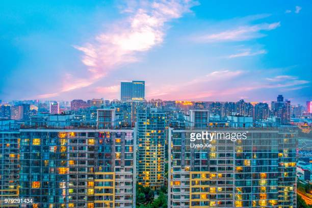 illuminated residential building - liyao xie stockfoto's en -beelden
