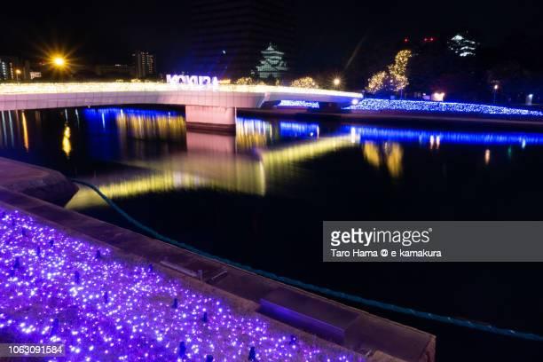 illuminated riverside in kokura area of kitakyushu city in fukuoka prefecture in japan - 北九州市 ストックフォトと画像