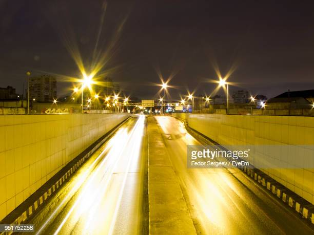 illuminated road against sky at night - fedor stock pictures, royalty-free photos & images