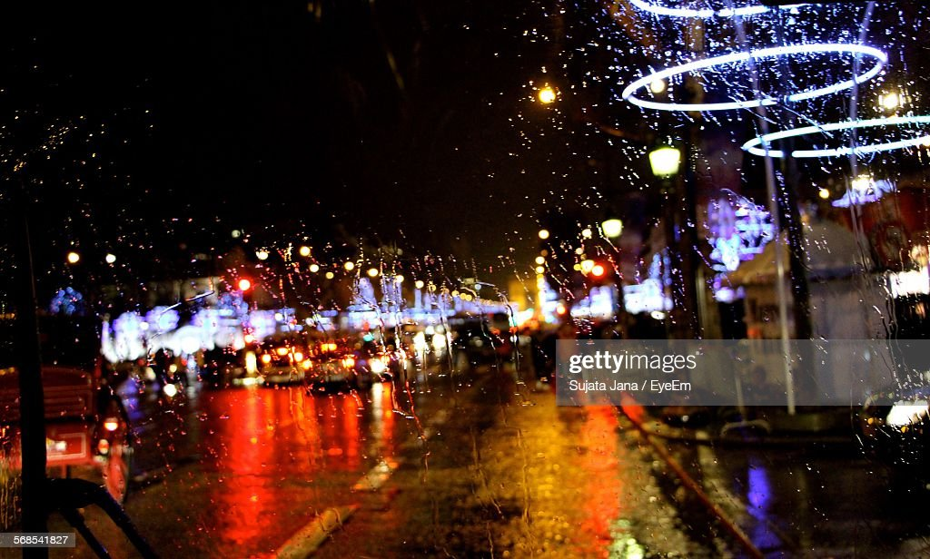 Illuminated Road At Night Seen From Wet Glass : Stock Photo