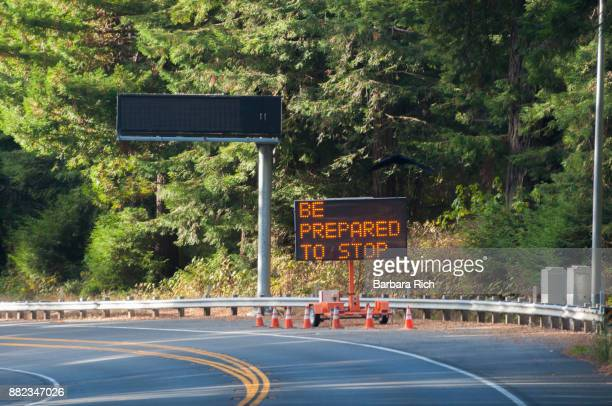 Illuminated road work sign on California Highway 101 north through Del Norte County warning be prepared to stop