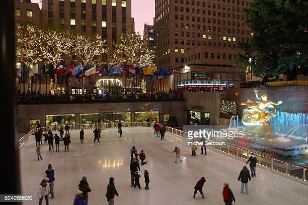 Illuminated Rockfeller center and ice rink before Christmas Photo by Michel Setboun/Corbis