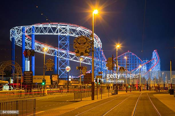 illuminated roller coaster at blackpool pleasure beach at night - blackpool beach stock pictures, royalty-free photos & images