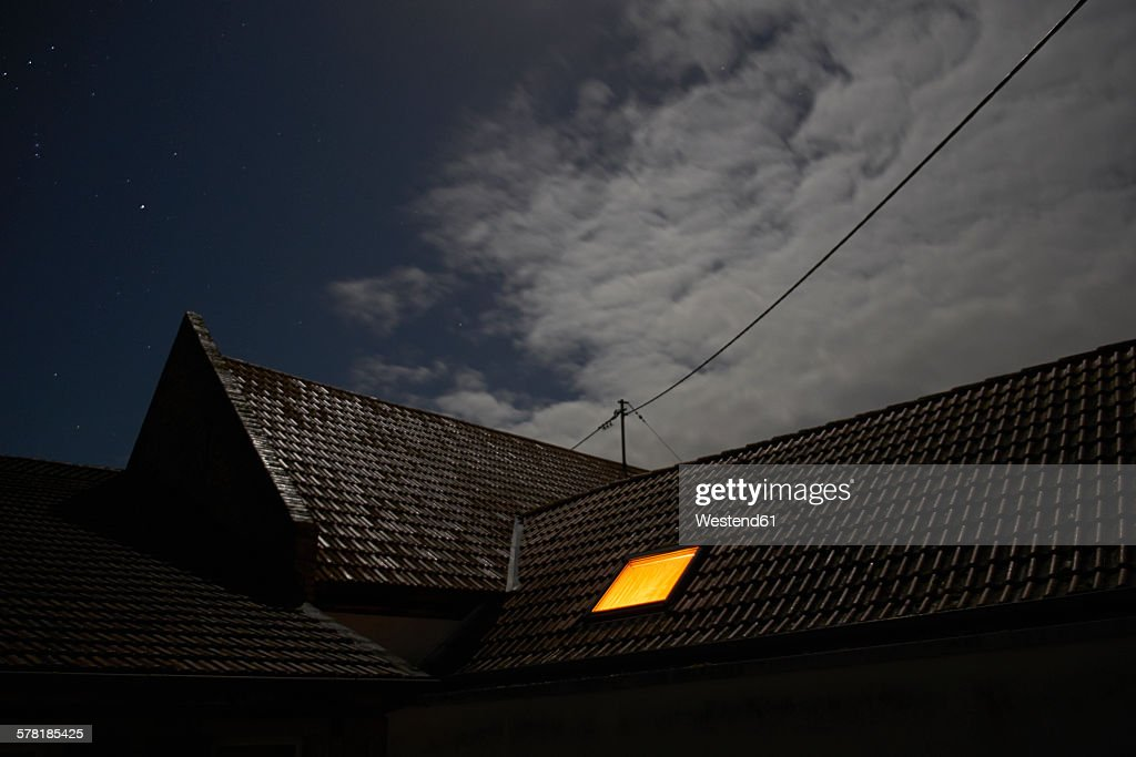 Illuminated roof window at night : Stock Photo