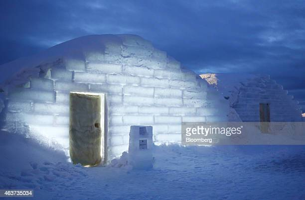 Illuminated rooms made from snow and ice stand at night at the Royce' Ice Hills Hotel in Tobetsu Hokkaido Japan on Sunday Feb 15 2015 The seasonal...