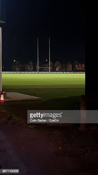 illuminated rugby field against sky at night - rugby field stock pictures, royalty-free photos & images