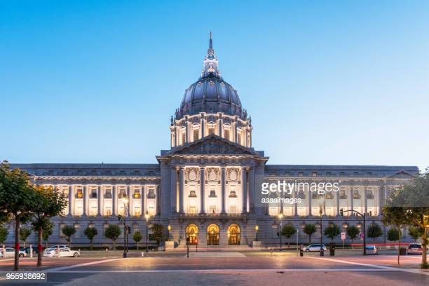 illuminated san francisco city hall - government building stock pictures, royalty-free photos & images