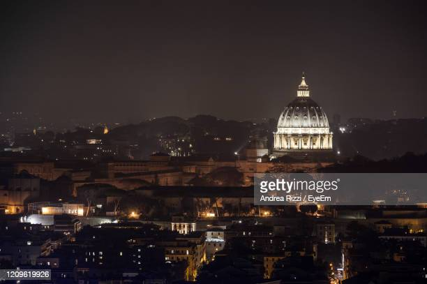 illuminated san pietro in vatican city against sky at night - andrea rizzi stock pictures, royalty-free photos & images