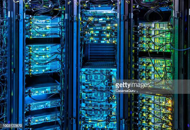 illuminated server room - data center stock pictures, royalty-free photos & images