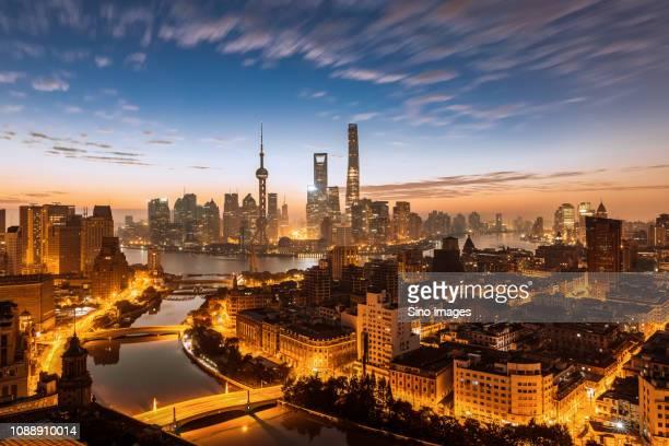 illuminated shanghai cityscape at sunset, china - image stock pictures, royalty-free photos & images