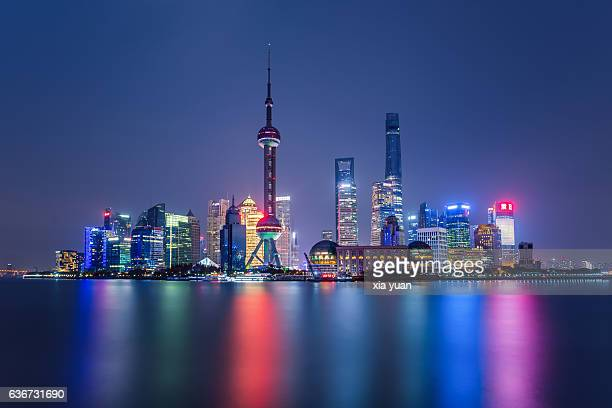 Illuminated Shanghai Skyline Reflecting On River