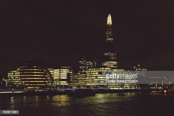 illuminated shard london bridge and buildings by thames river in city at night - bortes stock photos and pictures