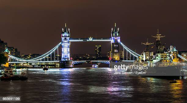 Illuminated Ship In Thames River Against Tower Bridge