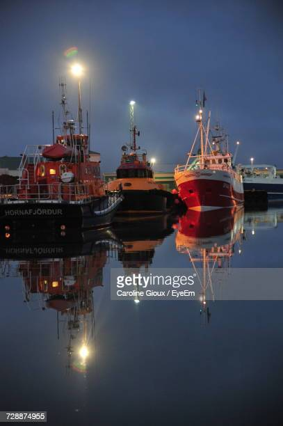 Illuminated Ship Moored At Harbor Against Sky At Night
