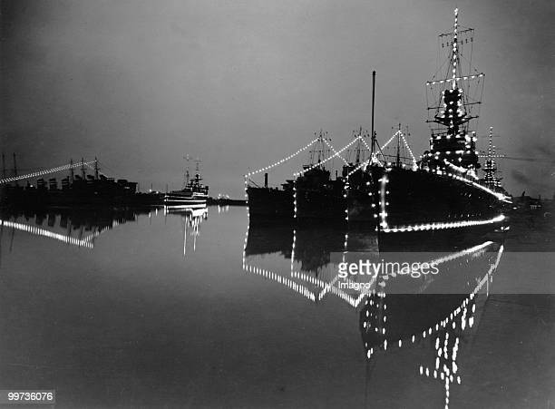 Illuminated ships in the dockyard at Chatham in Kent Photograph 1935 Photo by Austrian Archives /Imagno/Getty Images