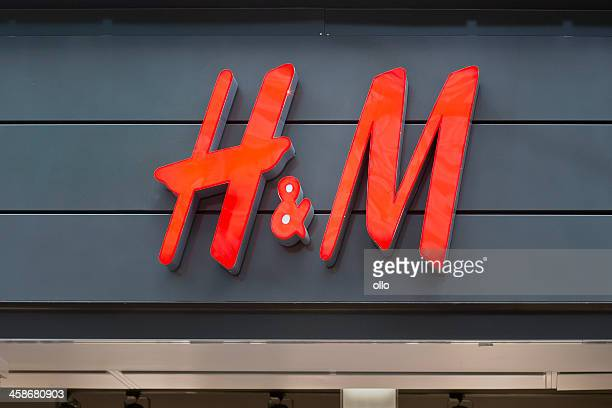 illuminated sign of h&m in wiesbaden, germany - letter m stock pictures, royalty-free photos & images