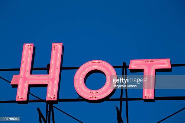 Illuminated sign on roof of hotel
