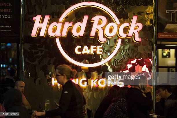 Illuminated signage is displayed on a terrace at the Hard Rock Cafe Hong Kong operated by Hard Rock International Inc in Hong Kong China on Monday...