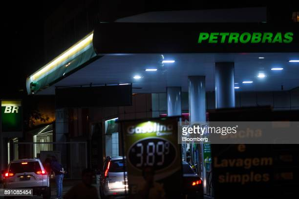 Illuminated signage is seen at a Petrobras Distribuidora SA gas station at night in Sao Paulo Brazil on Monday Dec 11 2017 Petroleo Brasileiro SA  is...