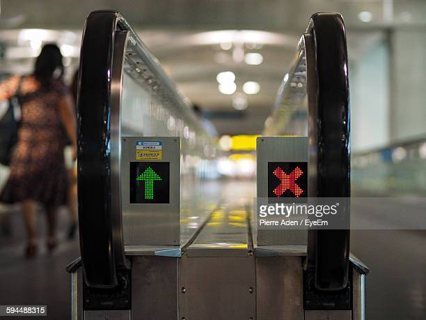 Illuminated Signs On Moving Walkway In Airport