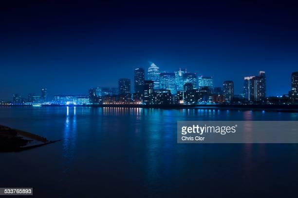 Illuminated skyline in cityscape at night, London, England, United Kingdom