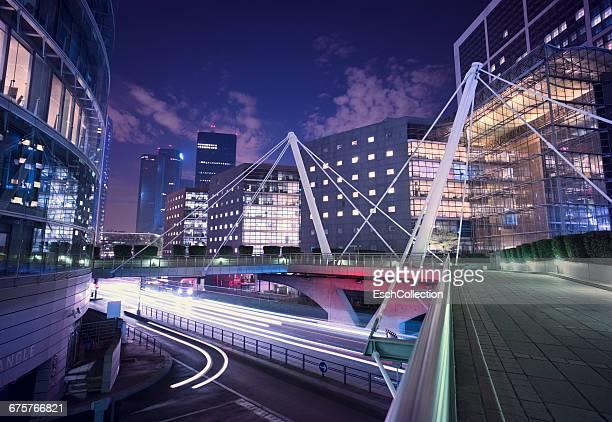Illuminated skyline of business district in Paris