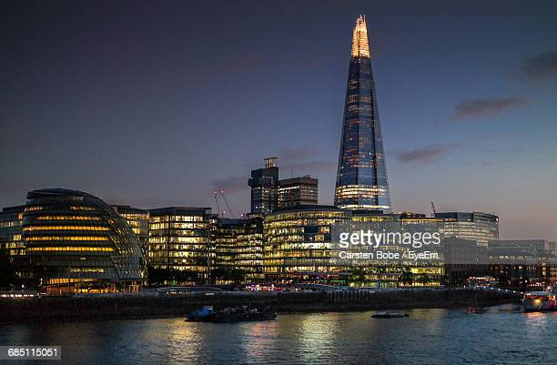 illuminated skyline of london by river thames at night - shard london bridge stock pictures, royalty-free photos & images