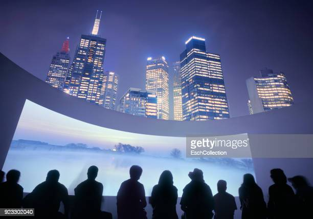 illuminated skyline with outdoor cinema, showing beautiful landscape - epic film foto e immagini stock