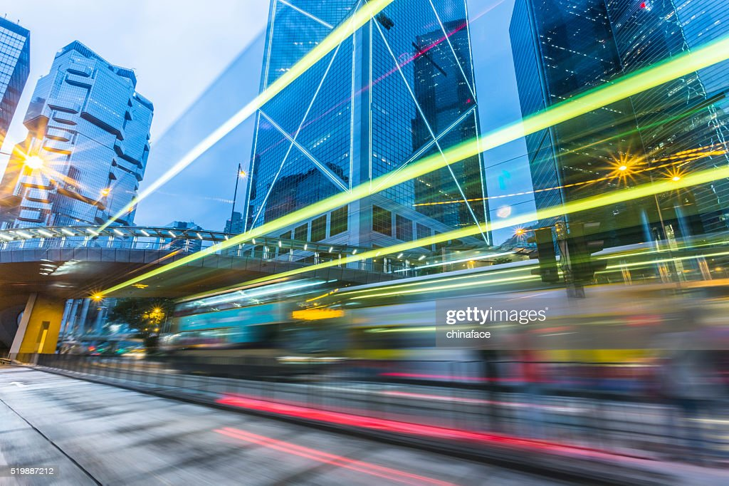 Illuminated Skyscrapers and light trails  in Hong Kong : Stock Photo