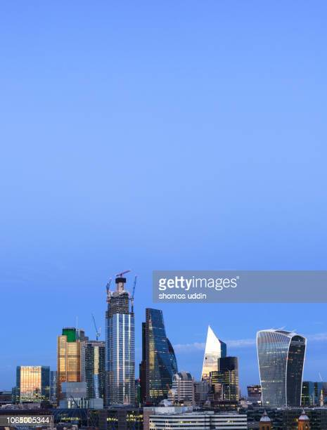 illuminated skyscrapers and the financial district of london at dusk - scalpel stock photos and pictures